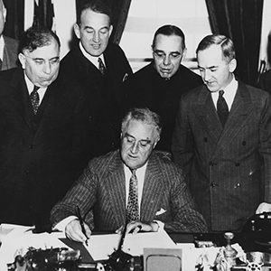 Franklin D. Roosevelt signs the New Deal