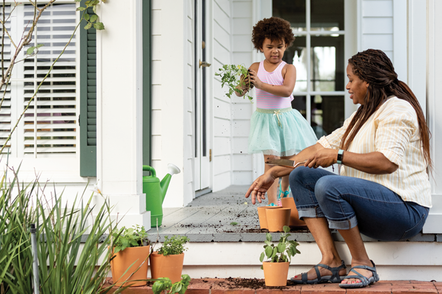 Mother and daughter with potted plants